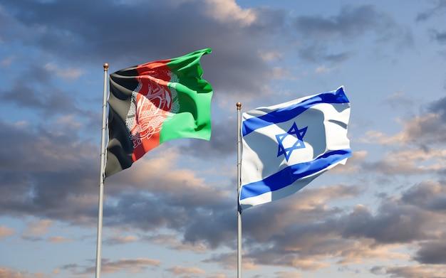 Vlaggen van israël en afghanistan samen met de hemelachtergrond
