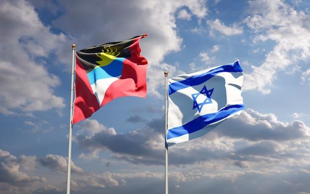 Vlaggen van israël en antigua en barbuda samen op hemelachtergrond