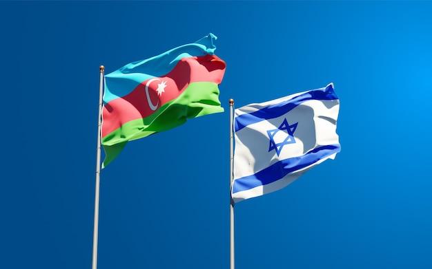 Vlaggen van israël en azerbeidzjan samen op hemelachtergrond