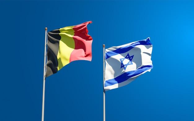 Vlaggen van israël en belgië samen op hemelachtergrond