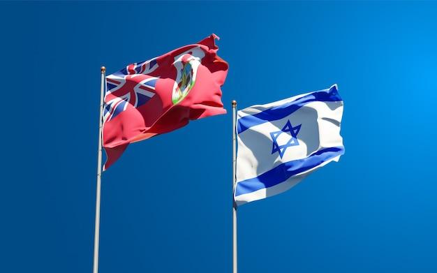 Vlaggen van israël en bermuda samen op hemelachtergrond