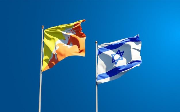 Vlaggen van israël en bhutan samen op hemelachtergrond