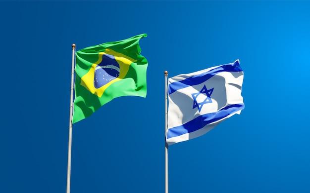 Vlaggen van israël en brazilië samen op hemelachtergrond