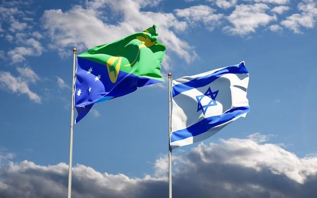 Vlaggen van israël en christmas island samen op hemelachtergrond