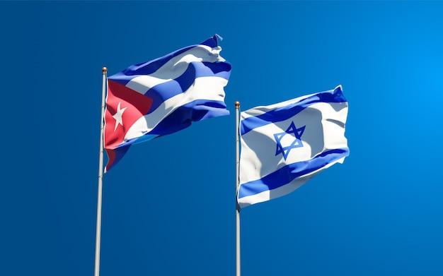 Vlaggen van israël en cuba samen op hemelachtergrond