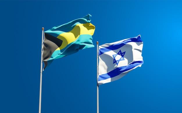 Vlaggen van israël en de bahama's samen op de hemelachtergrond