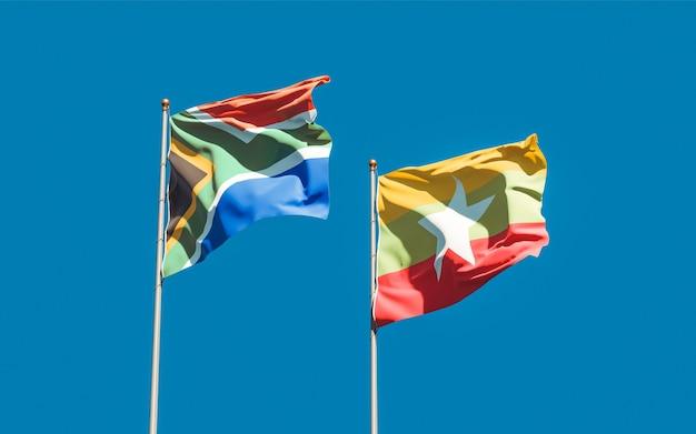 Vlaggen van myanmar en sar-afrikaan op blauwe hemel. 3d-illustraties