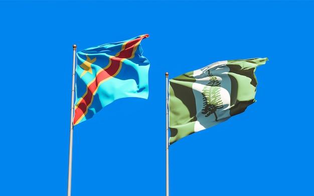 Vlaggen van norfolk island en dr congo op blauwe hemel. 3d-illustraties