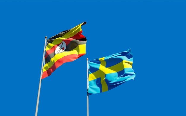 Vlaggen van oeganda en zweden op blauwe hemel. 3d-illustraties