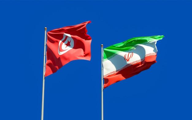 Vlaggen van tunesië en iran. 3d-illustraties