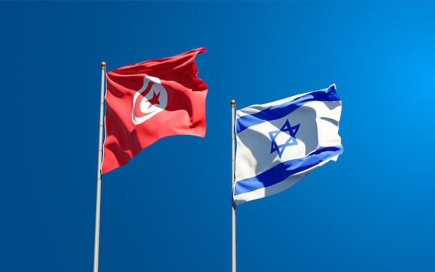 Vlaggen van tunesië en israël samen op hemelachtergrond