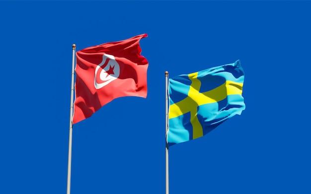 Vlaggen van tunesië en zweden op blauwe hemel. 3d-illustraties