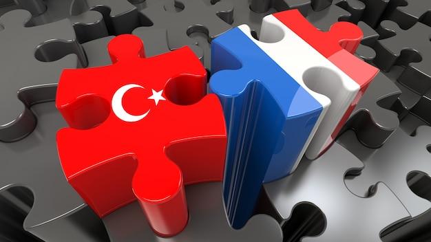Vlaggen van turkije en frankrijk op puzzelstukjes. politiek relatieconcept. 3d-rendering