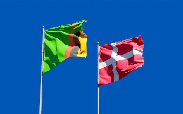 Vlaggen van zambia en denemarken. 3d-illustraties