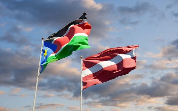 Vlaggen van zuid-soedan en letland. 3d-illustraties