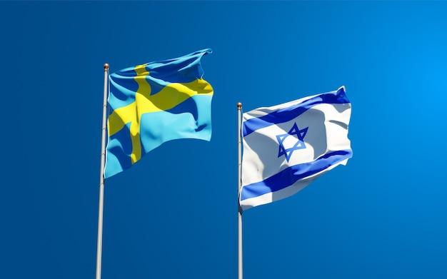 Vlaggen van zweden en israël samen op hemelachtergrond