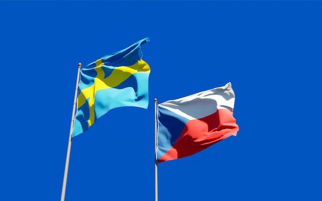 Vlaggen van zweden en tsjechisch op blauwe hemel. 3d-illustraties