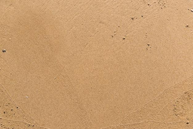 Vlak zand op een getextureerde strandachtergrond