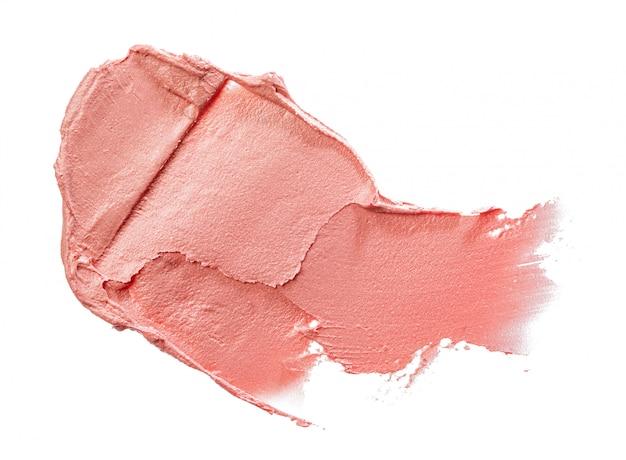 Vlekken van een roze lippenstift geïsoleerd op een witte achtergrond