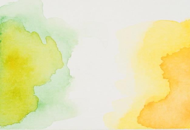 Vlekken van groene en gele waterverf