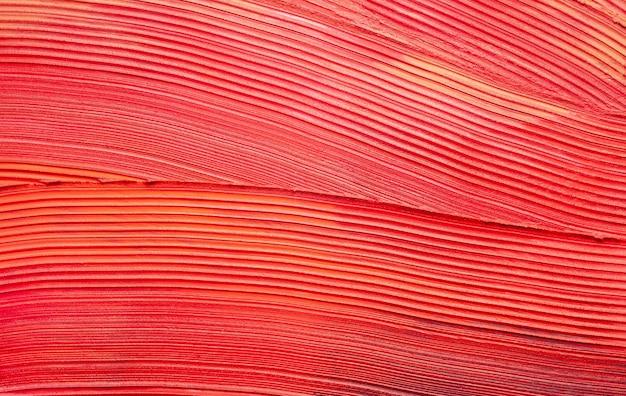 Vlekkerig rood oranje matte lippenstift textuur stevige achtergrond