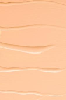 Vloeibare foundationtextuur. make-up voor vrouwen. bovenaanzicht.