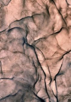 Vloeibare kunst marmeren textuur. achtergrond abstract iriserend verfeffect. vloeibaar acrylkunstwerk vloeit en spettert. gemengde verven voor interieur poster. alcoholinkt kleuren doorschijnend. design papier