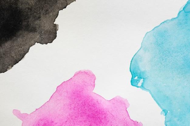 Vloeibare vlekken van kleurrijke tinten met de hand geschilderd
