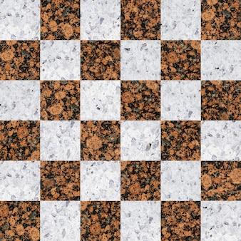 Vloertegels van gekleurd graniet. natuursteenmozaïek.