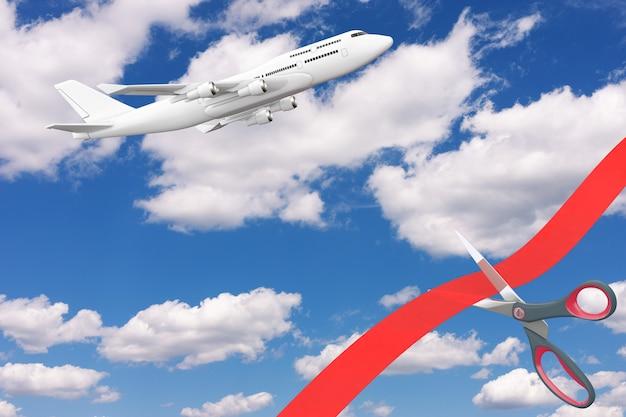 Vluchten openen na covid-19 quarantaineconcept. schaar snijden rood lint voor blauwe bewolkte hemel met witte moderne passagiersvliegtuig extreme close-up. 3d-rendering