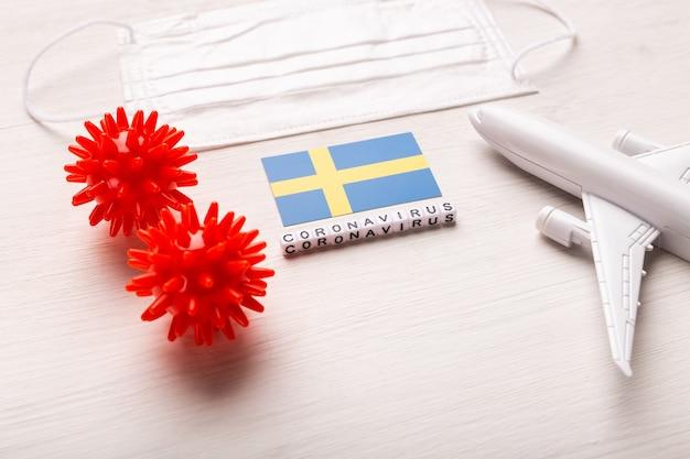 Vluchtverbod en gesloten grenzen voor toeristen en reizigers met coronavirus covid-19. vliegtuig en vlag van zweden op een wit