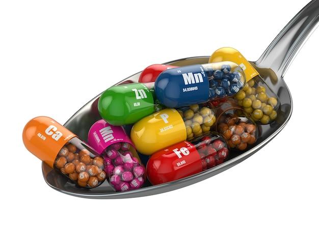 Voedingssupplementen. diverse pillen. vitaminecapsules op de lepel. 3d