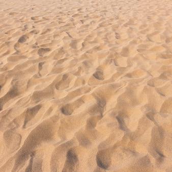 Voetafdrukken op zand