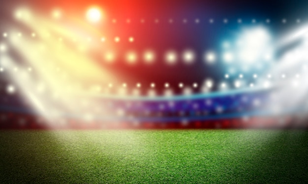 Voetbalgebied en schijnwerperachtergrond in het stadion Premium Foto