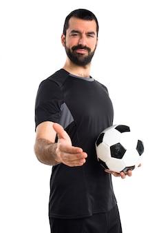 Voetballer die een deal maakt