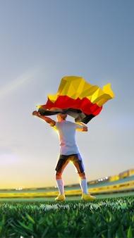 Voetballer na het kampioenschap van het winnaarspel houdt vlag van duitsland vast. veelhoekstijl