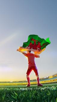 Voetballer na het kampioenschap van het winnaarspel houdt vlag van wales vast. veelhoekstijl