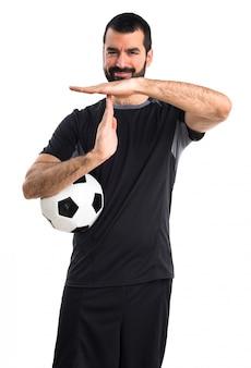 Voetbalspeler maakt tijd uit gebaar