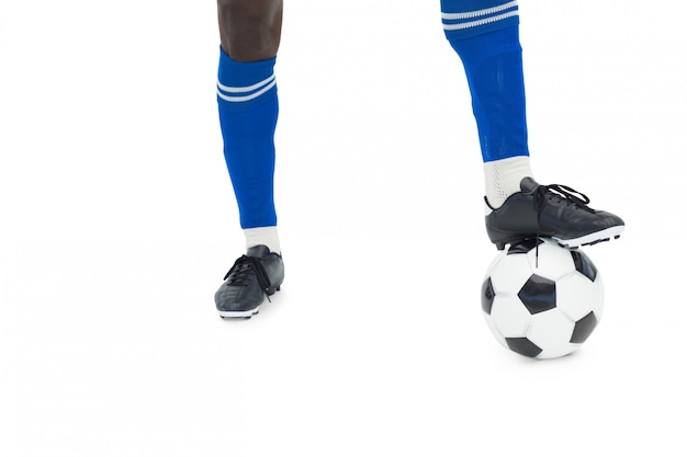 Voetbalster in blauw met bal