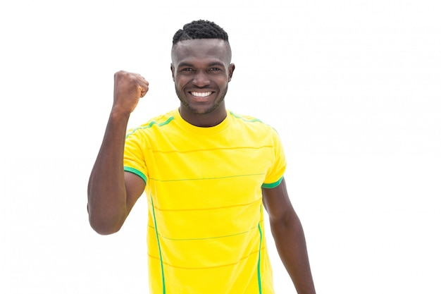 Voetbalster in geel een overwinning vieren