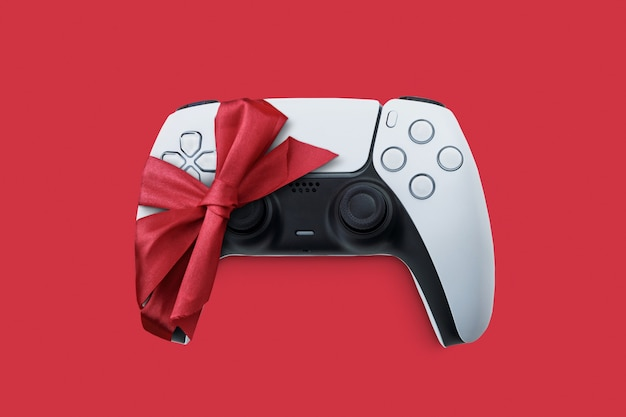 Volgende generatie witte gamecontroller cadeau verpakt met lint cadeau van de kerstman met kerstmis