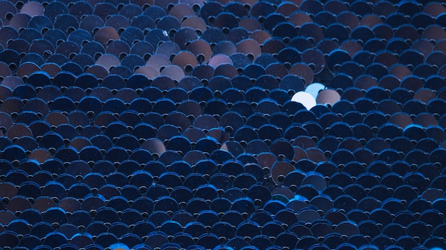 Volledig frame van blauwe lovertjes geweven achtergrond