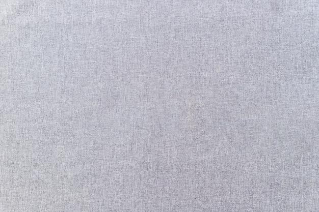 Volledig frame van de grijze achtergrond van de stoffentextuur