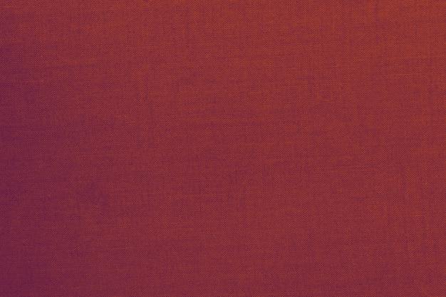 Volledig kader van rode textieltextuur nuttig voor achtergrond