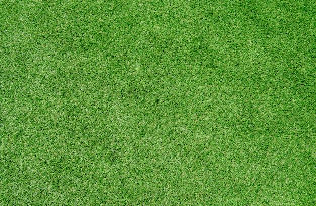 Volledig kaderschot van de groene achtergrond van de grastextuur.