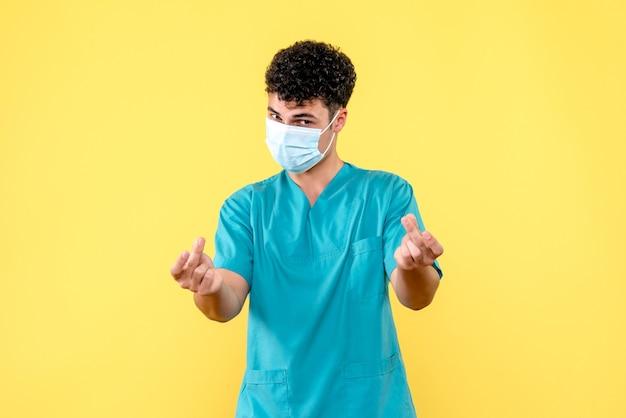 Vooraanzicht dokter de dokter met masker weet dat dokters patiënten met coronavirus kunnen genezen