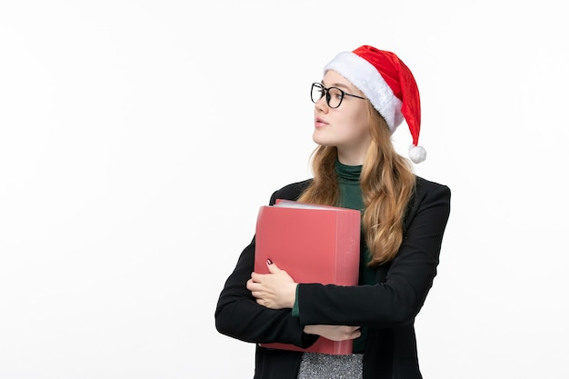Vooraanzicht jonge vrouwelijke student met bestanden boek school college