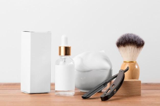 Vooraanzicht kapper winkel tools en witte verpakking voor olie
