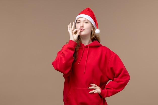 Vooraanzicht kerst meisje op bruine achtergrond vrouw vakantie kerst