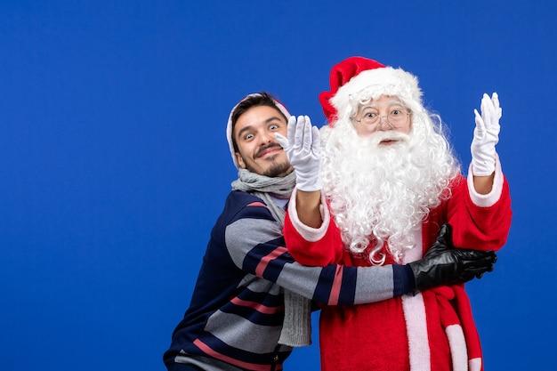 Vooraanzicht kerstman met jong mannetje